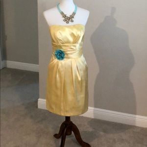 Cheery yellow mini dress with aqua flower